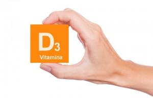 Mano con bloque naranja que dice vitamina D3
