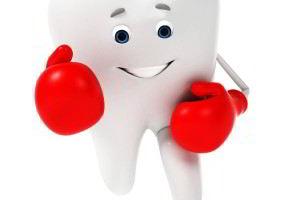 Personaje de un diente con guantes de box