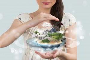Un acercamiento a mujer que tienen en las manos una esfera con una imagen de una imagen con aire limpio, energía aeolica, y espacios verdes