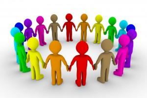 Iconos de personas de distintos colores tomandose de las anos formando un circulo