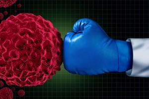 Guante de box golpeando ilustración de célula de cáncer