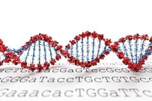 Cadena de ADN sobre una hoja llena con las letras TGac