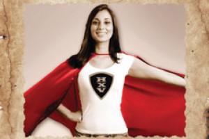 """Cartel con texto """"SE VUSCAN HEROINAS PARA SALVAR VIDAS"""" Con una mujer con capa"""