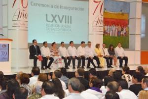 Funcionarios en el auditorio de XLVIII Reunión Anual de Salud Pública