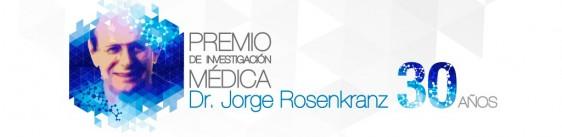 "Logotipo con el texto Premio ""Dr. Jorge Rosenkranz"" e ilustración del Dr. Jorge Rosenkranz"
