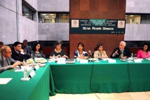 Funcionarios y Diputados en reunión de trabajo
