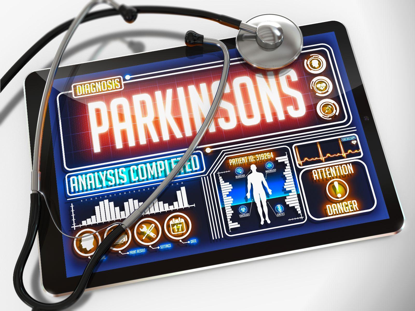 """Estetoscopio al lado de una pantalla de computadora con una ilustracipon y la palabra """"Parkinsons"""""""