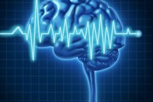 Ilustración de un cerebro con un electrocardiograma