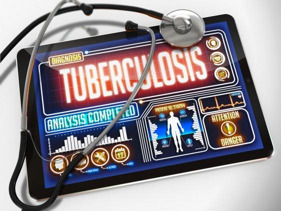 Pantalla de una computadora con la palabra tuberculosis y un estetoscopio