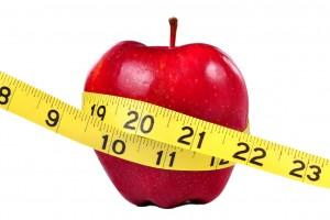 Manzana con una cinta métrica alrededor