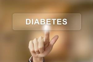 """Mano sobre una pantalla táctil tocando la palabra """"diabetes"""""""