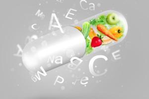 Ilustración de capsula con frutas y vitaminas