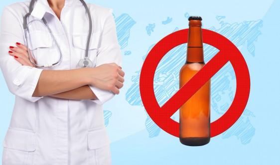 Doctora al lado de un símbolo de  dejar de tomar