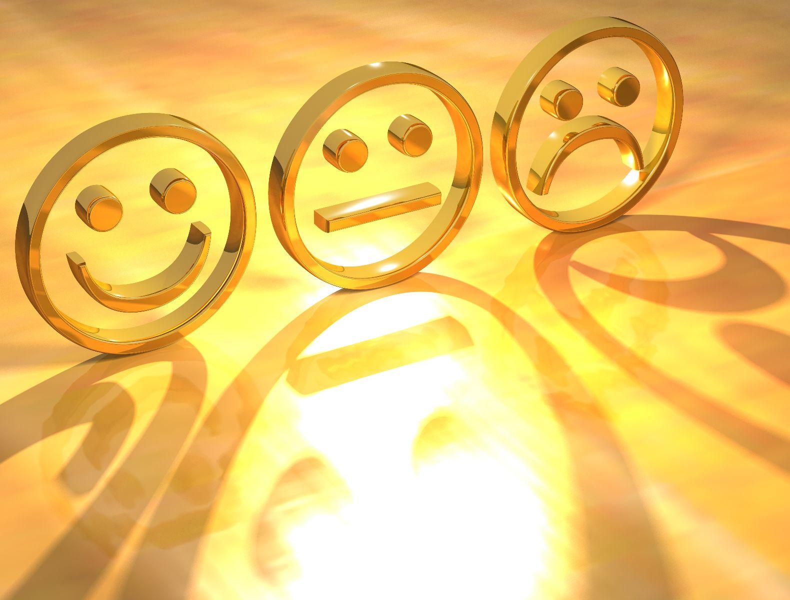 Icono en color oror de sonrisa normal y tristeza en fondo amarillo