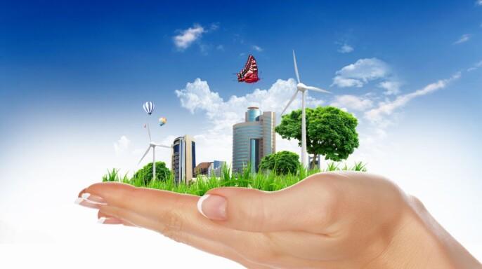Ilustración de una mano sosteniendo ciudad verde
