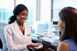 Breast Surgery Consultant Meeting With Female Patient