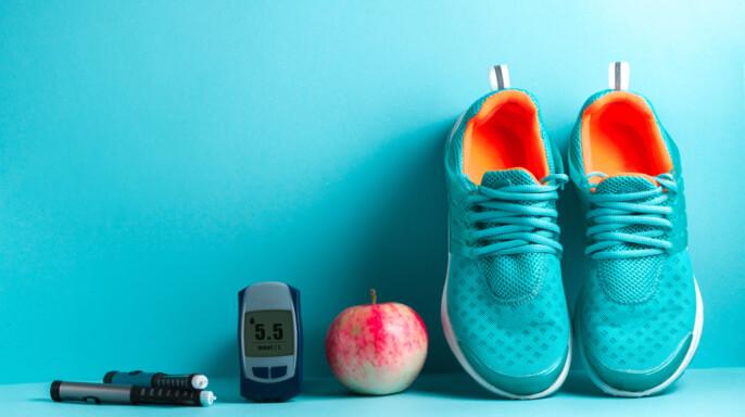 tenias, fruta y medidor de glucosa